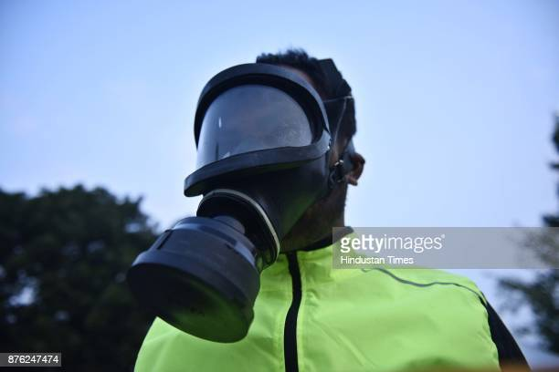 A person wears a protective mask to protest against the polluted Air during the Airtel Delhi Half Marathon 2017 at JLN Stadium on November 19 2017 in...