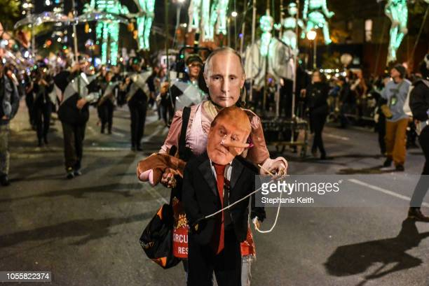 A person wears a Vladimir Putin and Donald Trump themed costume in the annual Village Halloween parade on Sixth Avenue on October 31 2018 in New York...