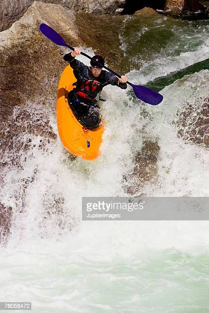 Person whitewater rafting