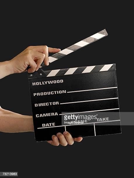 person with a clapperboard - clapboard stock pictures, royalty-free photos & images