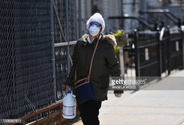 Person with a face mask carries a gallon of bleach on April 07, 2020 in Brooklyn, New York.