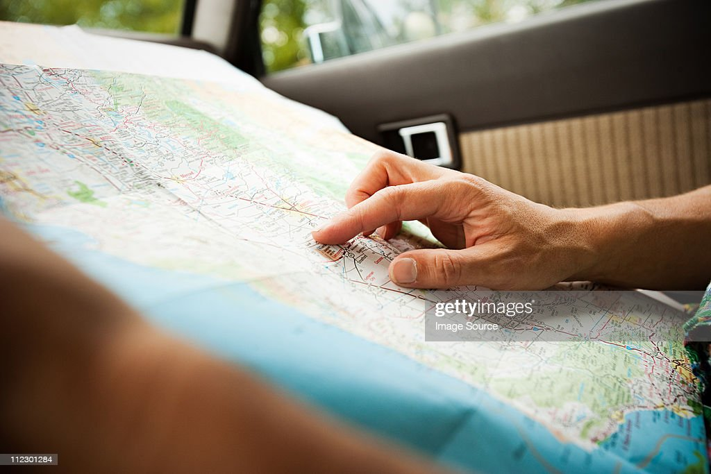 Person with a map : Stock Photo