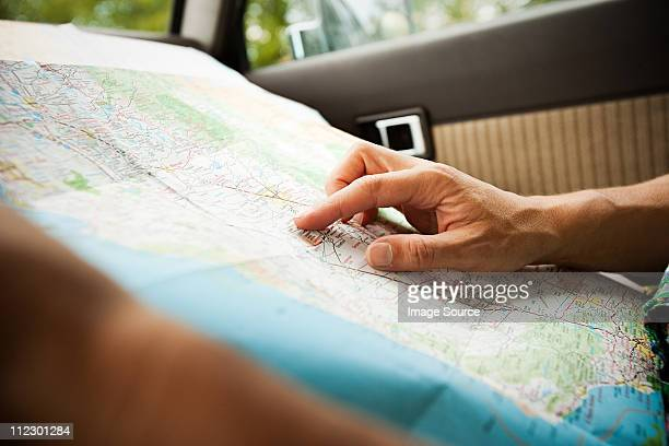 person with a map - cartography stock photos and pictures