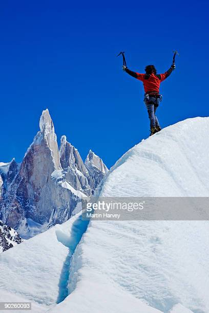 Person with arms raised on mountainside in Santa Cruz Province, Argentina