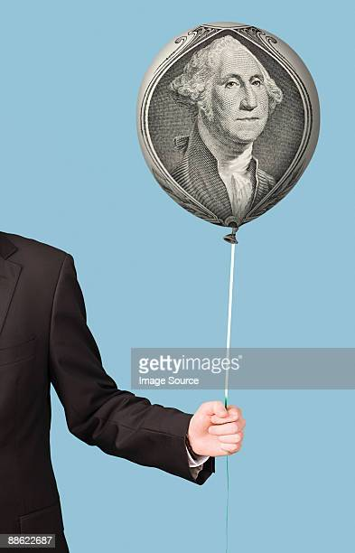 person with banknote balloon - inflation stock photos and pictures