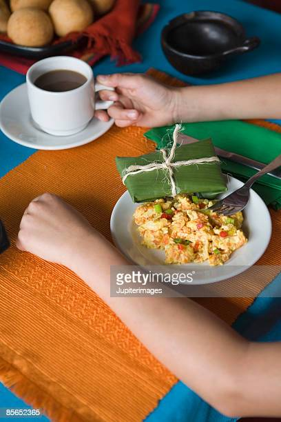 Person with Colombian breakfast