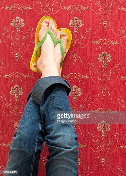 Person with feet on wall