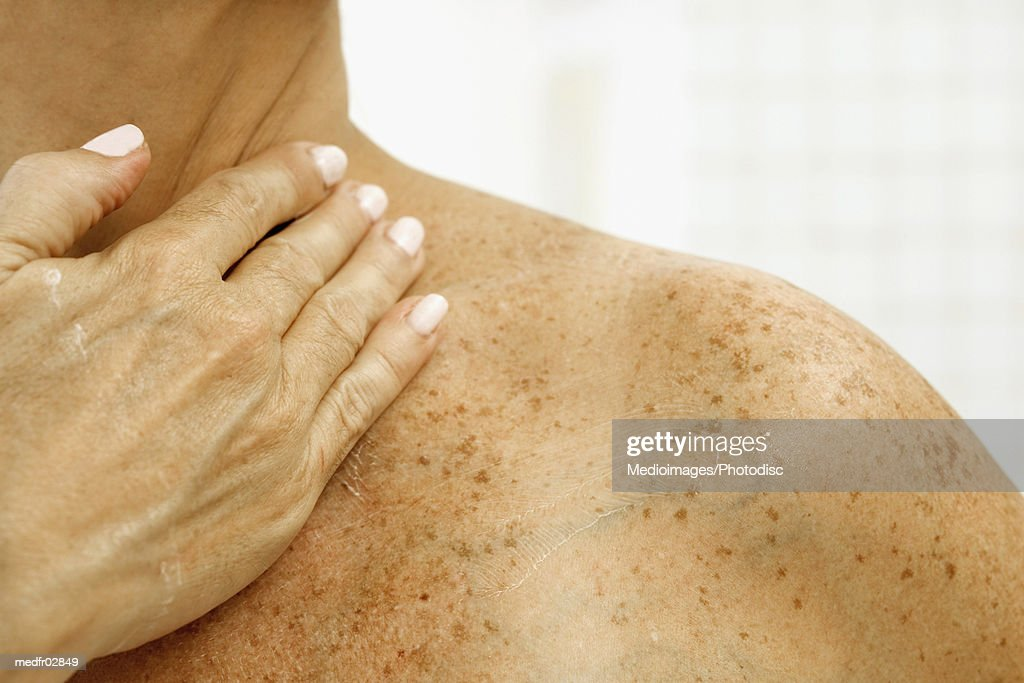 Person with hand on throat, close-up : Stock Photo