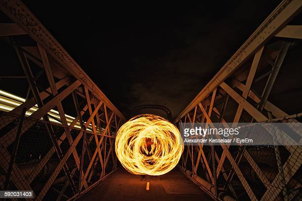 Person With Illuminated Wire Wool On Footbridge