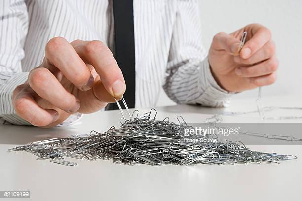 person with paperclips - paper clips stock photos and pictures