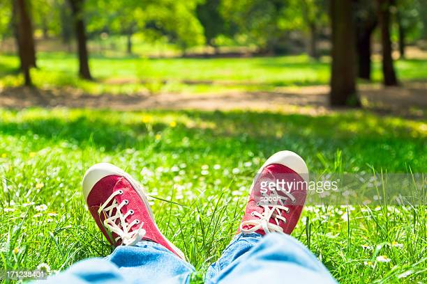 Person with red shoes in park in Rome