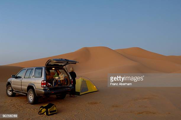 Person with tent and SUV in desert , Rub al Khali , Dhofar , Oman