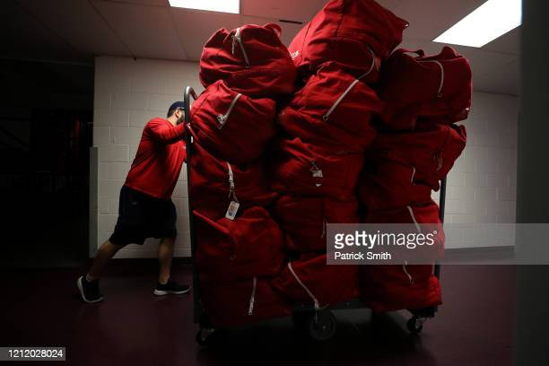 A person with the Detroit Red Wings rolls equipment bags down the hall after the Detroit Red Wings against the Washington Capitals game was postponed...