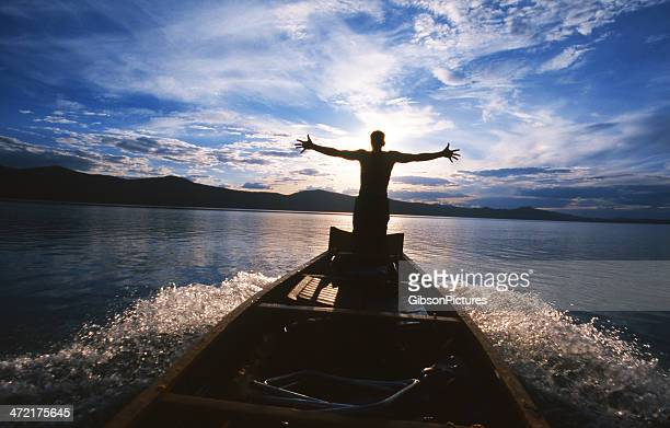 a person with their hands spread on the edge of a boat - data lake bildbanksfoton och bilder