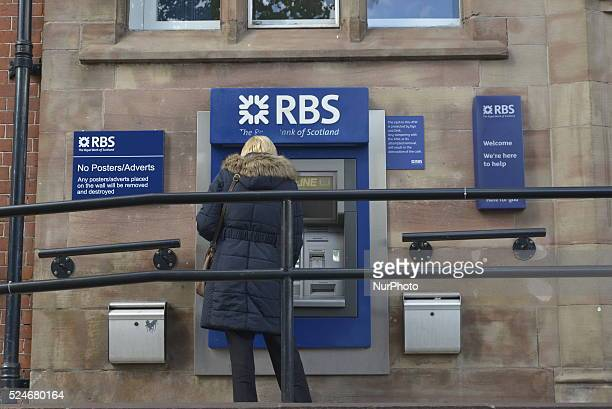 Person withdrawing cash from a Royal Bank of Scotland branch in Manchester on Tuesday 19th May 2015. -- Barclays Bank and the Royal Bank of Scotland,...