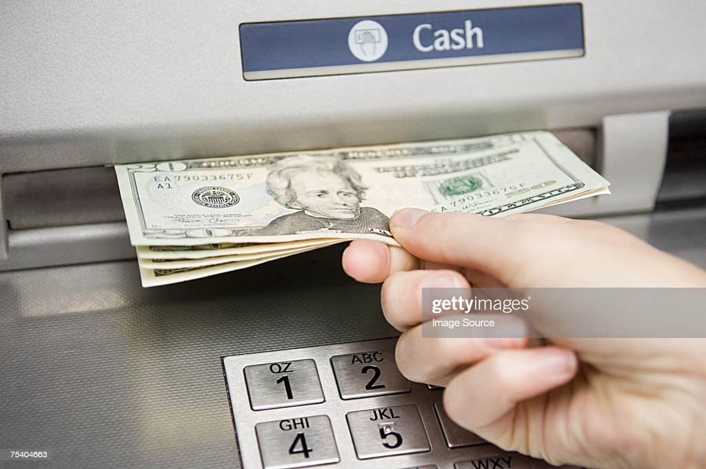 Person withdrawing cash : Stock Photo