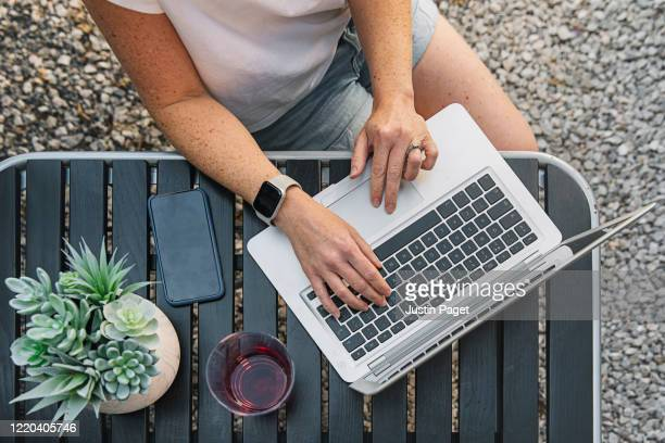 person working from garden - working stock pictures, royalty-free photos & images