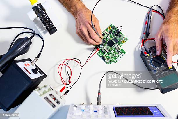 person working in an electronics lab - oscilloscope stock pictures, royalty-free photos & images