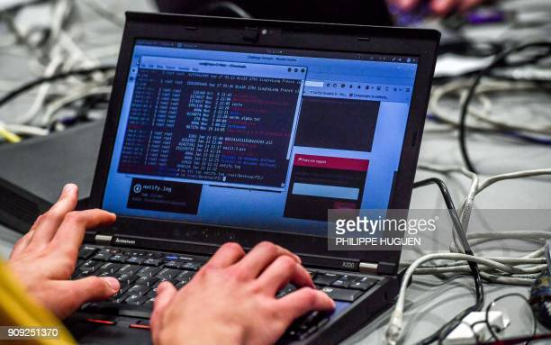 A person works at a computer during the 10th International Cybersecurity Forum in Lille on January 23 2018 / AFP PHOTO / Philippe Huguen