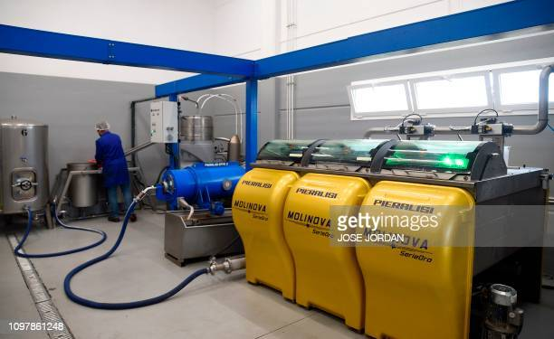 A person works at an olive oil factory in Oliete northeastern Spain on December 17 2018 Residents began moving away from rural towns and villages...