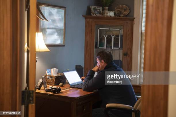 Person works from home on a laptop computer in Princeton, Illinois, U.S., on Friday, Sept. 11, 2020. Illinois reported 1,337 new coronavirus cases...