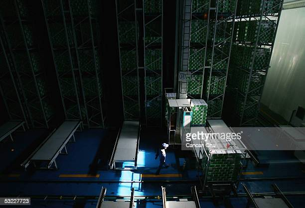 A person works in a storehouse at Mengniu Dairy Co Ltd's modern dairy farm July 12 2005 in Hohhot Inner Mongolia autonomous region in north China The...