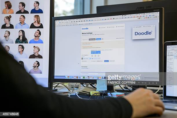 A person works on a computer at the office of Swiss website Doodlecom a platform for interactive diaries and surveys on November 18 2014 in Zurich...