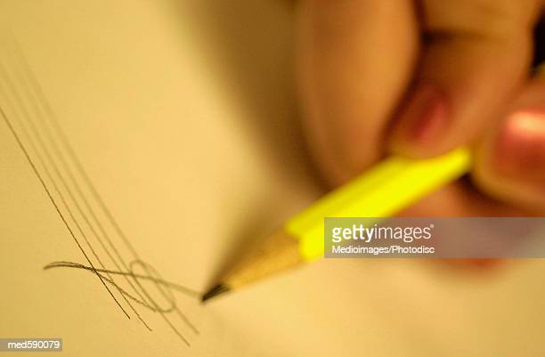 Person writing music with a pencil