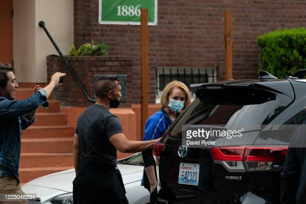 Person yells as Seattle Mayor Jenny Durkan leaves a meeting with protesters from the Capitol Hill Organized Protest at First African Methodist...