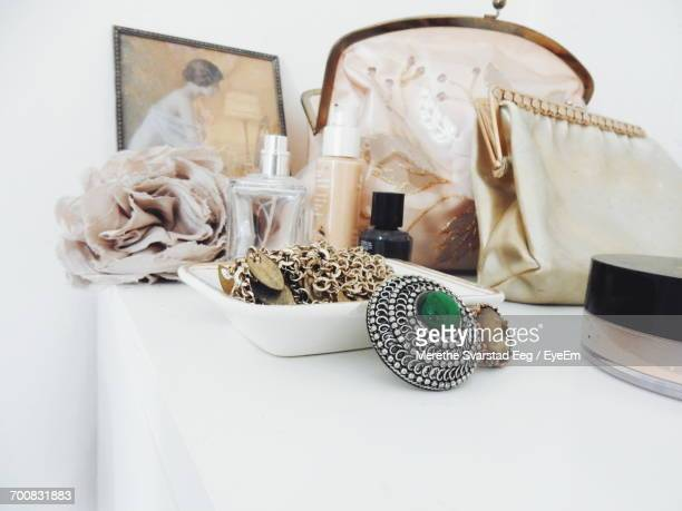 personal accessories in room on table at home - pendant stock pictures, royalty-free photos & images