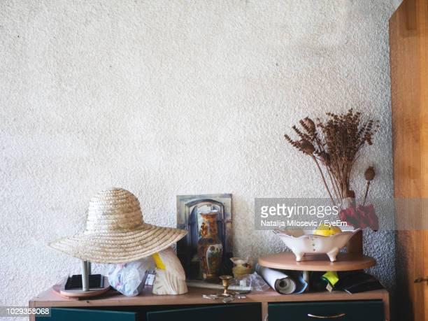 Personal Accessories On Table Against Wall At Home