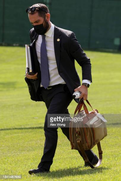 Personal aide Stephen Goepfert walks on the South Lawn after he returned to the White House with U.S. President Joe Biden September 20, 2021 in...