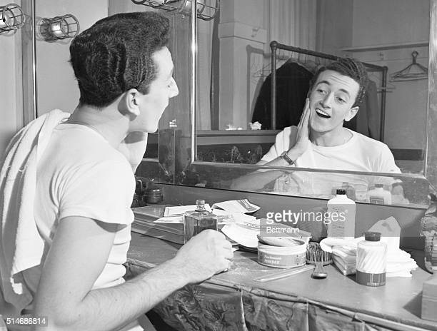 Personal appearances call for stage make-up to offset the harsh glare of the footlights and Vic Damone is shown in a dressing room where he once...