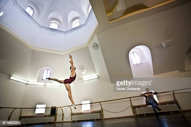 Personal Ballet rehearsal by Viktor Barykin Ballet Master repetiteur teaching with Corps de Ballet dancer Igor Tsvirko jumping in Arabesque position...