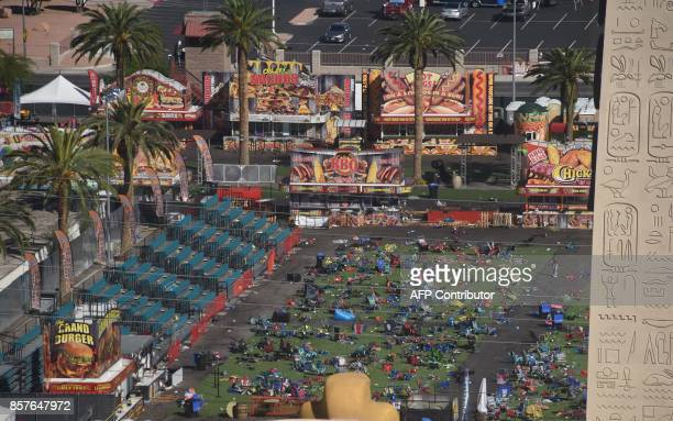 TOPSHOT Personal belongings are gathered on the ground at the venue of the Route 91 Harvest Festival venue where FBI investigators continue work in...