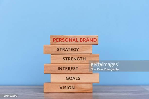 personal brand concept wood block - individuality fotografías e imágenes de stock