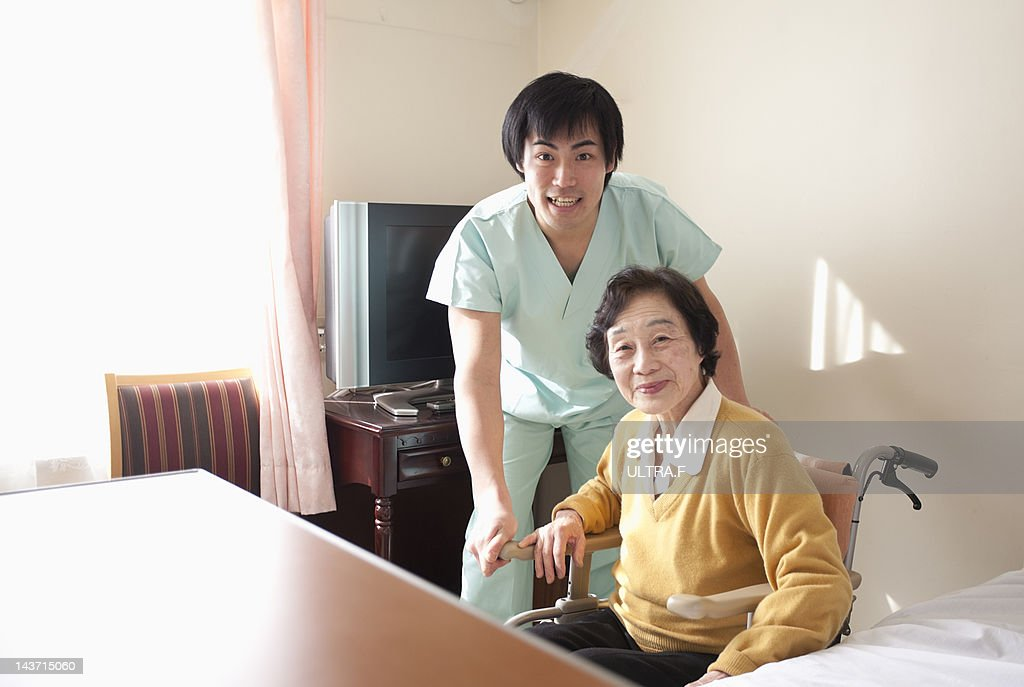 Personal Care Assistant And Senior Woman Stock Photo | Getty Images