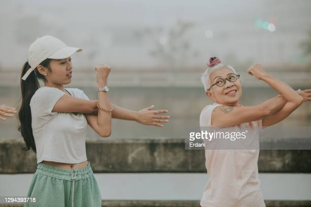 personal coach for excercising-stock photo - thai ethnicity stock pictures, royalty-free photos & images