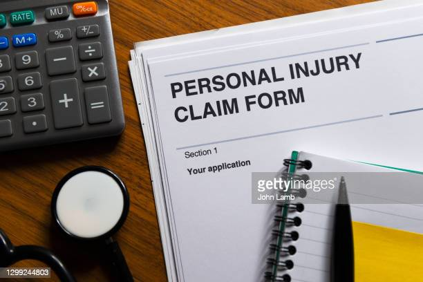 personal injury claim form close-up. - workers compensation stock pictures, royalty-free photos & images