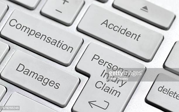 personal injury claim keyboard - injured stock pictures, royalty-free photos & images