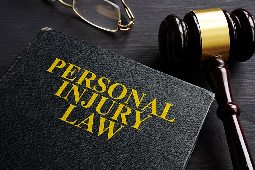 Personal Injury Law book and a black desk. 1070418448