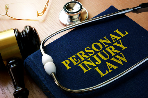 Personal Injury Law concept. Book and stethoscope. 867503464