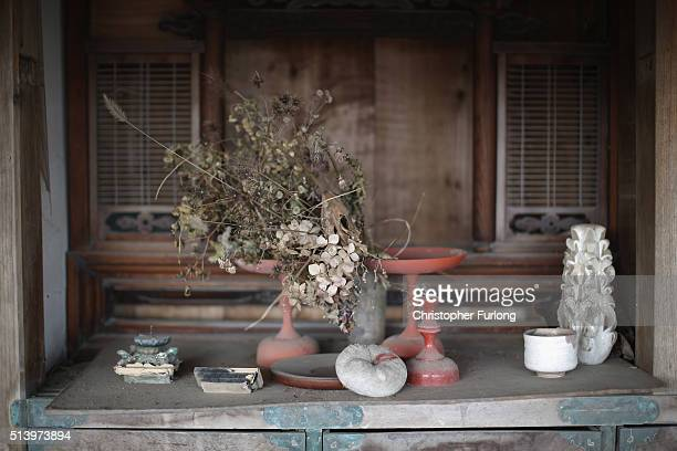 Personal items are strewn around a tsunami damaged home inside the exclusion zone close to the devastated Fukushima Daiichi Nuclear Power Plant on...