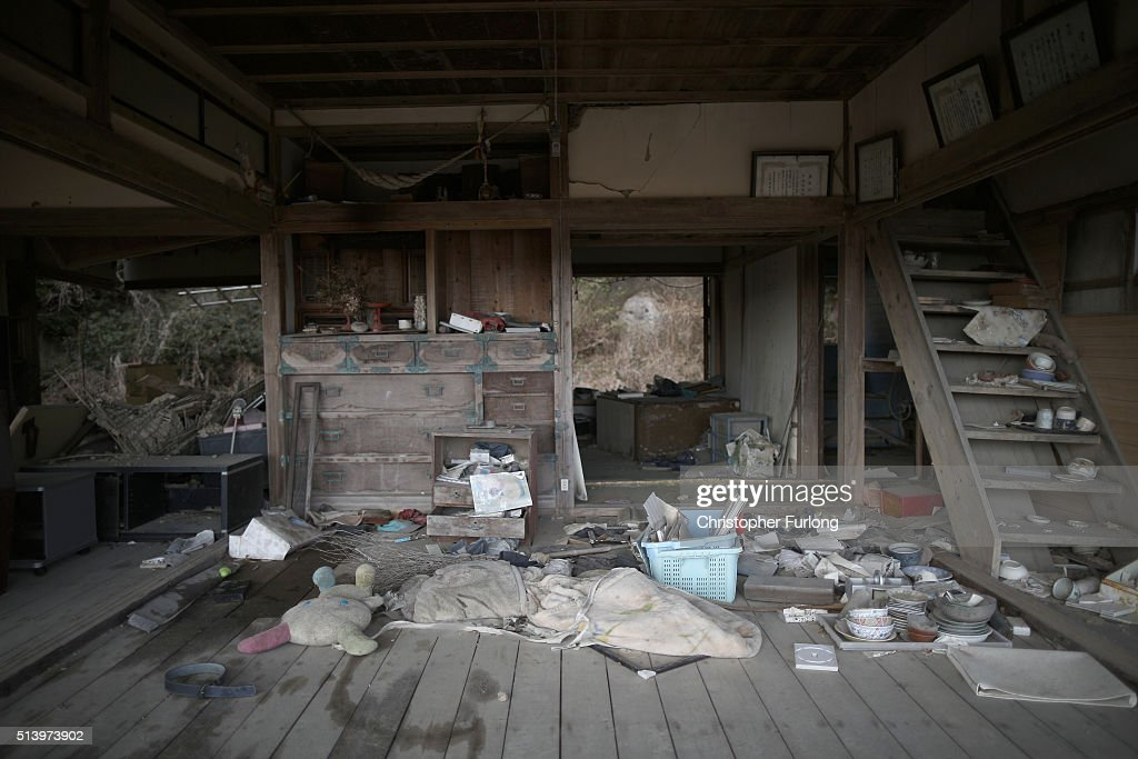 Personal items are strewn around a tsunami damaged home inside the exclusion zone close to the devastated Fukushima Daiichi Nuclear Power Plant on February 26, 2016 in Minamisoma, Fukushima, Japan. March 11, 2016 marks the fifth anniversary of the magnitude 9.0 earthquake and tsunami which claimed the lives of 15,894, and the subsequent damage to the reactors at TEPCO's Fukushima Daiichi Nuclear Power Plant causing the nuclear disaster which still forces 99,750 people to live as evacuees away from contaminated areas.