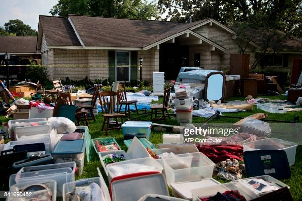 Personal items from a once flooded home are seen displayed for insurance adjusters as residents begin the recovery process from Hurricane Harvey...