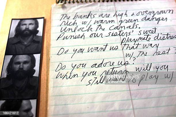 Personal note books and some of the last pictures of The Doors lead singer Jim Morrison are displayed at the Park Avenue Armory which is hosting the...