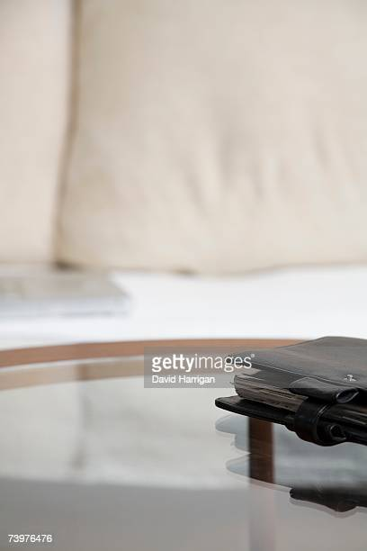 Personal organizer on a glass coffee table in front of a sofa