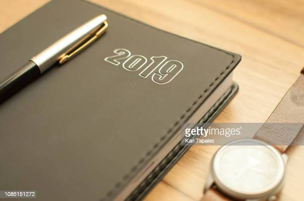 A 2019 personal organizer on a wooden table