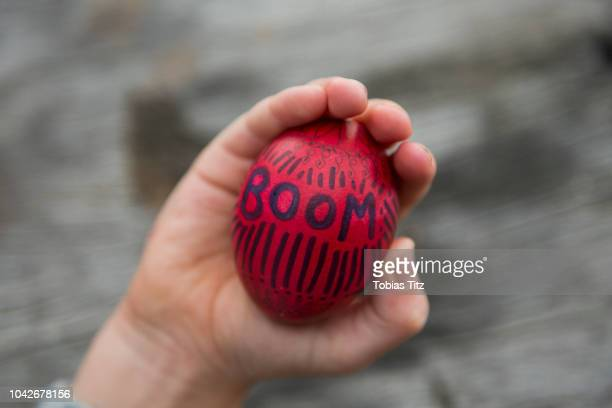 personal perspective boy holding easter egg - happy easter text stock pictures, royalty-free photos & images
