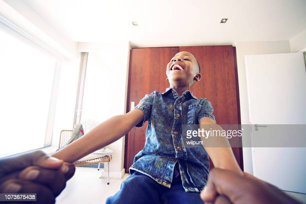 personal perspective having fun holding boy's hands - personal perspective stock pictures, royalty-free photos & images